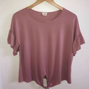 Caution to the wind: blush top with ruffle sleeve